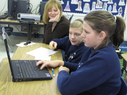 Students Using a Laptop Computer