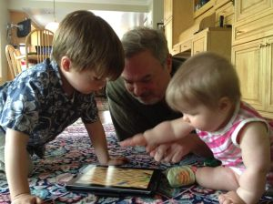 Paul with Grandkids and iPad